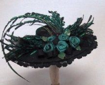 Millinery in Miniature - Page 2 How to make tiny roses and bows, and trim with lace and feathers. Excellent site.