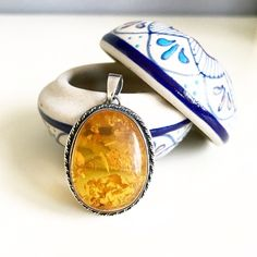 Vintage sterling silver amber pendent Vintage sterling silver amber pendent that belonged to my grandmother. She purchased it during her trip to Japan. ❤️All my jewelry items are buy one get one 50% off. Free beauty gift with $25 purchase. Free shipping with $75 purchase.❤️ Vintage Jewelry
