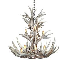 Real antler chandelier-dining table?  A fun touch in the room