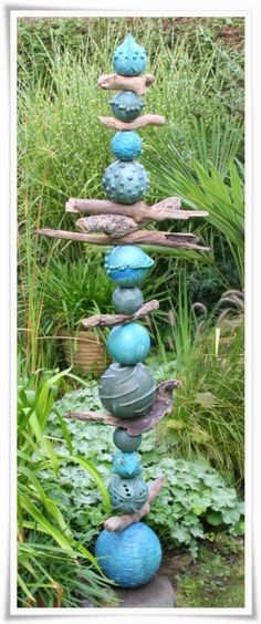What a FUNtastic Totem, like Water Bubbles intermixed with the Driftwood...LOVE!! Artist....????