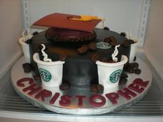 Starbucks Graduation Cake  Starbucks Graduation Cake Marble vanilla and chocolate cake with fresh strawberry buttercream filling. Covered in black fondant with