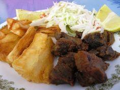 Yuca frita, or deep-fried yuca, often accompanies chicharon