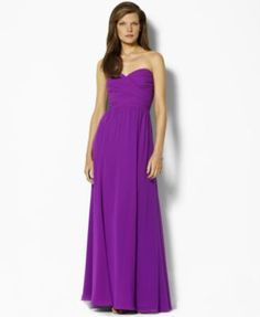 Exuding elegant glamour, the beautiful floor-grazing Lauren by Ralph Lauren gown is designed in lustrous georgette  with a crossover sweetheart neckline for feminine charm.