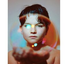 Portrait of a boy named Max by #London photographer Hollie Fernando (@holliefernando). To submit your images for consideration on our feed follow @childhoodeveryday and tag your photos #childhoodeveryday. // #childhood #portrait #soapbubble #bubbles #rainbow