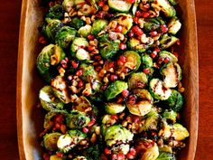 Simple and delicious side dish with roasted Brussels sprouts, toasted walnuts, pomegranate molasses & seeds. Recipe for pomegranate molasses.