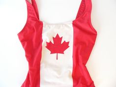 This very patriotic bathing suit is red and white and has a big old maple leaf in the middle. Bathing Suits, Red And White, Flag, Buy And Sell, Swimsuits, Canada, Stuff To Buy, Etsy, Clothes
