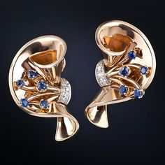 Gracefully fashioned twisted ribbons are centered with a sparkling fountain of sapphires and diamonds in these cool and artsy French made Retro earrings, rendered in radiant rose-gold, dating from the glamorous 1940s. Ooh-la-la! 1 1/4 inches high by 3/4 inch wide.