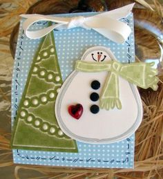 This was a class project.  A box to hold Christmas Tags, using Lasting Impressions' templates, a ribbon and a little faux stitching.