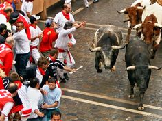 """*SPAIN~Running of the Bulls, Pamplona Pamplona's festival of San Fermín gained international renown after Ernest Hemingway wrote about it in The Sun Also Rises. The sometimes deadly """"running of the bulls"""" happens each morning of the nine-day festival. San Fermin Pamplona, Pamplona Spain, Best Places To Travel, Places To See, Running Of The Bulls, The Sun Also Rises, Festivals Around The World, Spain And Portugal, Travel Scrapbook"""
