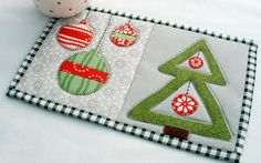 Decorate your mug rug tree with baubles as shown here for a modern look, or hearts for a country feel.  Both designs are detailed in my Christmas Mug Rugs collection.