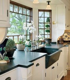 Love the dark bench top against the white cupboards! Also awesome country style sink & great windows