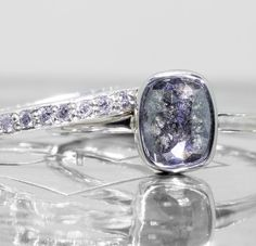 Our new 1.27 carat salt and pepper diamond ring in 14k recycled white gold. Absolutely beautiful!