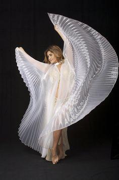 White Sheer Organza  Dancing Wings Sheer Organza Wings.   Black Light Reactive. Permanent Sunburst Pleat.  Removable Clear Lucite Wands.  http://www.dancingwings.com/sheer-organza.html