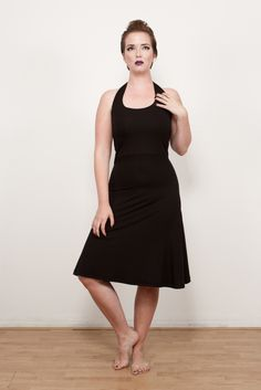 Jane haltertop dress in black with lined top for comfort and shape with a flowing a-line skirt