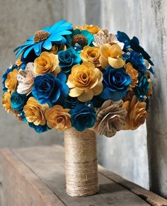 Wood/Paper bouquet with gold and blue!