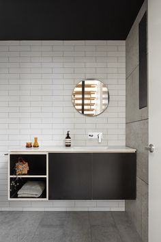 Contemporary powder room with concrete tiles, plywood vanity, and corian stone benchtop.