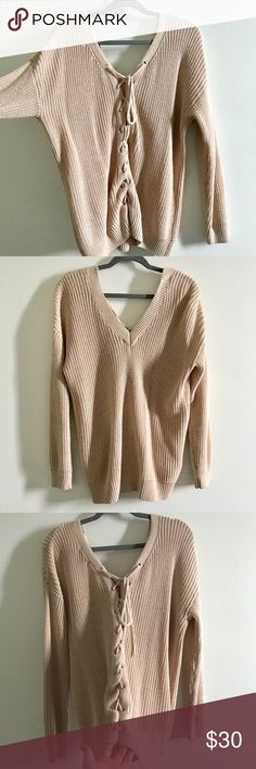 Trendy Long Sweater Super trendy and cozy ! Nice color, comfy, fits oversize, cool lace up in the back! First pic is from the back, it can be wear however you want ! Worn only once, great condition ! Forever 21 Sweaters V-Necks