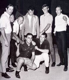 "Elvis, early photo with some of the ""Memphis Mafia.""  Kneeling, I recognize GK and Joe. Not sure who the others are."