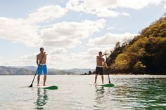 Stand up paddle surfing. I have always wanted to try this! :)