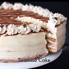 Moist sponge cake soaked in coffee liqueur and layered between a rich mascarpone cream. This tiramisu cake recipe is guaranteed to become a new favorite. #tiramisu #tiramisucake #italiancake #coffeecake #italiandeesert #classicdessert