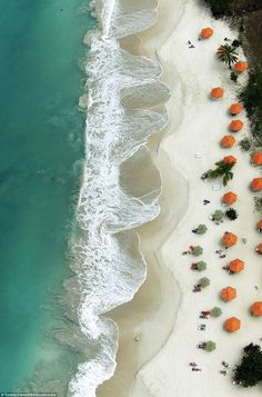 No drones for photographer Tommy Clarke. For his aerial photographs of land and sea he hires a helicopter or a tiny plane and dangles out of them to nail the perfect shot like this one of the waves breaking in Antigua.