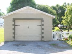 What is left to do? 1.  Finish painting block 2.  Dark moss paint on roof trim 3.  Big metal star  painted in country red to correspond with house shutters. 4.  Sconces or metal planters on each side of garage door. 5.  Address sign