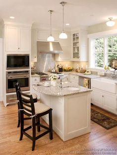 @Joy Miller another kitchen idea I like the panels on the island and open window with no blinds