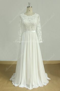 Romantic A line vintage chiffon lace wedding dress with nude lining and long sleeves Fabric: Chiffon, Lace Embellishment : lace Silhouette: A line Neckline: Sweetheart Sleeves: Long sleeves Hemline:Full Length Back: Zipper up Photo in ivory chiffon lace, nude lining. FAQ Q: How