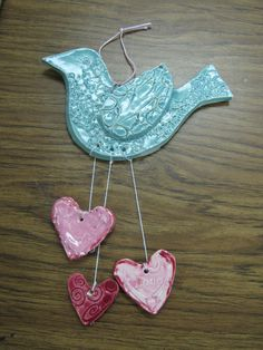 American folk art ceramic bird with hearts by a 1st grader; lesson by art teacher: Susan Joe