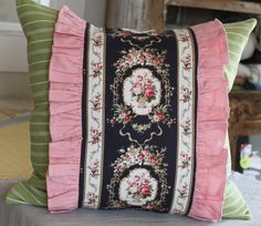 Cottage pillow using antique reproduction print with pink ruffle, striped green, and golden yellow back. Size 20 x 20. For more information, email or call.  mrslemon@sbcglobal.net 714.350.3187