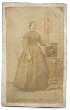 ca. 1860-90s, [carte de visite portrait of a female photographer,  identified on verso as G. H. Jenkinson, posed with her wet-plate camera]