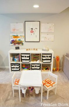 Toy storage ideas source: Freckles Chick website Chic playroom featuring Ikea Expedit Shelving Unit filled with The Container Store Rugby Stripe Bins, toys and books. Ikea Latt Children's Table and Chairs with Target pillows doubling as cushions. Playroom Storage, Kids Room Organization, Playroom Decor, Playroom Ideas, Playroom Design, Playroom Seating, Bedroom Seating, Playroom Layout, Playroom Table