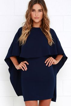 Things are looking up with items like the Best is Yet to Come Navy Blue Backless Dress making their way into your wardrobe! A unique, backless silhouette is created by woven poly fabric that drapes into a front tier, and transitions into cape sleeves that trail out at back alongside the sheath skirt. Hidden back zipper.