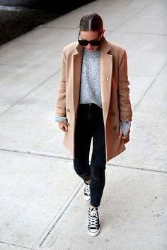 The slick hair and big shades give this otherwise very plain look some chic.
