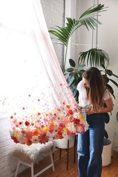 Add pretty flowers to the bottom of your curtains to create a decorative touch. Hot glue the flowers in a whimsical pattern.