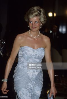 The Princess of Wales attends a banquet at the President's palace in Yaounde, Cameroon, wearing a blue Catherine Walker dress, March 1990.