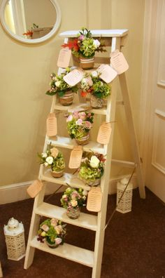 Whilst our Bride & Groom enjoyed the Autumn Sunshine and some celebratory drinks a transformation was taking place... The Step Ladders had now become the all important Seating Plan