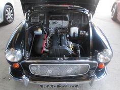A Morris Minor customer of ours came to buy some parts of us at the David Manners Group earlier and couldn't resist showing us his new engine. John buys all his parts from us, and we have seen the speed he gets to when leaving our car park and we recommend you challenge him at your own peril! His black Morris Minor was also featured in Morris Minor Magazine on the front cover. Since then, we have helped him rebuild his Morris Minor even further. http://www.jagspares.co.uk/Morris/company.asp
