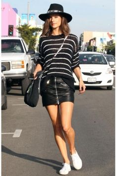 Alessandra Ambrosio wearing Superga Classic Sneakers in White, Ale by Alessandra Santa Fe Hat, Tod's Mini Wave Bag, IRO Odessa Sweater and Anine Bing Moto Leather Skirt