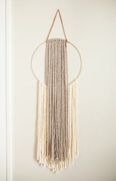 This chunky wool yarn wall art piece makes a statement on any wall in your space