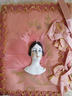 This is a darling little Art Deco period, Ca hankie press. The hankie press is decorated with a hand painted, porcelain, half doll flattie. Doll Head, Doll Face, Boudoir, Hat Stands, Half Dolls, Fine Porcelain, Porcelain Tiles, Art Deco Period, Ribbon Work