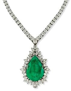 AN EMERALD AND DIAMOND PENDENT NECKLACE designed as a detachable pendant mounted with a pear-shaped emerald surrounded by a graduated vari-cut diamond festoon, to the graduated brilliant-cut diamond necklace