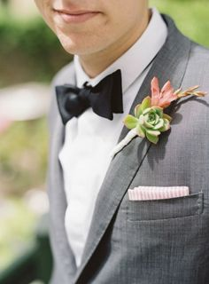 i love everything about this. the gray suit is perfect, the pocket square with just a hint of pink, and another pop of pink in the boutonniere. yes!