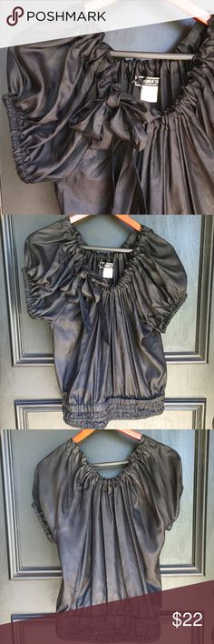 """Fumblin' Foe Ebony Silk Top Stylish black 100% silk top, size small. Has adorable draw string neck line and 3"""" waist hem. Draw string neck line allows shirt to drape off the shoulder or style how you choose. 24"""" Length Fumblin Foe Tops Blouses"""