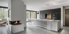 Bright white kitchen, dark windows, contemporary lines, modern _ Culimaat - High End Kitchens | Interiors | ITALIAANSE KEUKENS EN MAATKEUKENS - BloxX