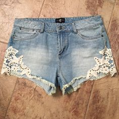 Final Price Denim shorts Denim shorts with cute studded flowers on the legs! Not sure if I actually ever wore these! They're in brand new condition! They need to go, so let me know if you're interested!  Shorts Jean Shorts