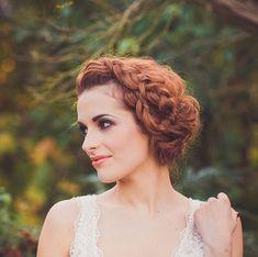 Braided bun and swirls by Rock My Wedding