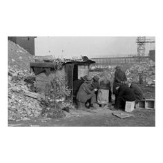 Unemployed & Homeless 1938 - Unemployed workers in front of a Hooverville shack with Christmas tree, East 12th Street, New York City. Photographed by Lee Russell, January 1938. (https://twitter.com/HawCreekShop/status/529446094720471040) (http://haw-creek.com/shop/homeless-and-unemployed-1938-2/)