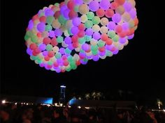 Borealis at Phish Festival 8 by Hector Serrano.  We made a colorful blimp out of 300 balloons.  The size was 10'x30' and was tethered to a movie camera dolly.  We  paraded it through the crowd to a wildly positive reception.  Check out this video around 2:22 http://www.youtube.com/watch?v=oV9IVVmp4Mo
