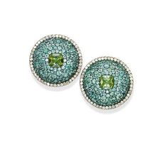 JAR Paris. A PAIR OF EXQUISITE TOURMALINE AND DIAMOND EAR CLIPS, BY JAR. Each designed as a pavé-set Paraïba tourmaline shield, centering upon a cushion-shaped green tourmaline, to the single-cut diamond border, made in 1995, 2.8 cm long, with French assay marks for platinum and gold, in a JAR pink leather case. Signed JAR Paris. Price Realized $215,362 / Estimate $44,681 - $67,021.  Emma Checkley, Head of the Jewellery Department, Paris -  'Uniqueness of design, each made only once…